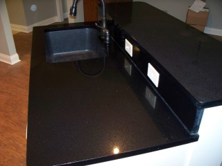 Scratches repaired on Black Night quartz countertop.