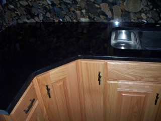 Scratches repaired on Absolute Black granite.
